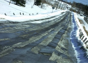Ruts in the slush on the road create driving hazards